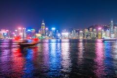 Hong Kong - January 10, 2018 :Chinese wooden sailing ship with r. Ed sails in Victoria harbor at Hong Kong Island, landmark Stock Photo