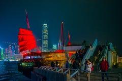 Hong Kong - January 10, 2018 :Chinese wooden sailing ship with r. Ed sails in Victoria harbor at Hong Kong Island, landmark Royalty Free Stock Photo