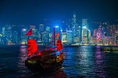 Hong Kong - January 10, 2018 :Chinese wooden sailing ship with r. Ed sails in Victoria harbor at Hong Kong Island, landmark Royalty Free Stock Images