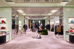 Prada store. HONG KONG - JANUARY 27, 2016: inside of Prada store. Prada S.p.A. is an Italian luxury fashion house, founded in 1913 by Mario Prada Royalty Free Stock Images