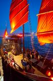 Hong Kong. JANUARY 25, 2016: the red sails of Aqua Luna at twilight. The Aqua Luna is a Chinese Junk operating in Victoria Harbour Royalty Free Stock Photography