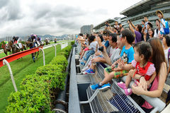 Hong Kong Jockey Club's Pre-season Carnival. A fully-fledged pre-season grass trial offers visitors an opportunity to experience the power and speed of Stock Images