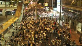 Hong Kong 1 July Marches 2014. Tens of thousands of residents joined a march to push for democracy. Participants had hoped to surpass the 500,000 that turned out stock video footage
