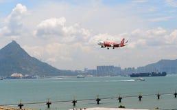 AirAsia. HONG KONG - JUNE 04, 2015: Air Asia aircraft landing at Hong Kong airport. AirAsia Berhad is a Malaysian low-cost airline headquartered near Kuala stock image