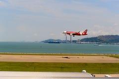 AirAsia. HONG KONG - JUNE 04, 2015: Air Asia aircraft landing at Hong Kong airport. AirAsia Berhad is a Malaysian low-cost airline headquartered near Kuala stock photography