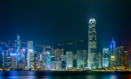 HONG KONG - June 14: Hong Kong city skyline. At night over Victoria Harbor June 14 2014. Victoria Harbour is a natural landform harbour situated between Hong Stock Photo