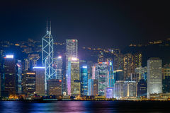 HONG KONG - June 14: Hong Kong city skyline. At night over Victoria Harbor June 14 2014. Victoria Harbour is a natural landform harbour situated between Hong Stock Photos