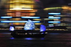 Hong Kong Junk Boat Motion Blur. Traditional Chinese junk boat Aqua Luna with blue and white porcelain like sails on a tour of Victoria Harbour in Hong Kong royalty free stock photo