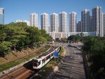 Hong Kong Kina - November 18 2015: LRT är ett ljust stångsystem fungerings av MTR Korporation som tjänar som Tuen Mun, Yuen Long  royaltyfri fotografi