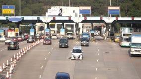 Hong Kong Kowloon East TKO tunnel, avgiftstation på Lam Tin i Hong Kong lager videofilmer