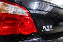 Hong Kong, Hong Kong - 25 2018 Kwiecień: Zakończenie Subaru loga taillights na tyły czarny Subaru WRX i odznaka Zdjęcie Stock
