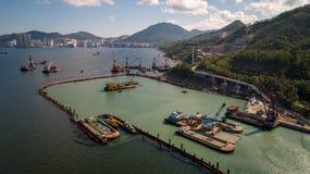 Hong Kong Lam Tin Tunnel construction Drone Shot. Sea sky Stock Photos