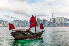 Hong Kong Landscape: Chinese Sailboat on Victoria Harbor Stock Images