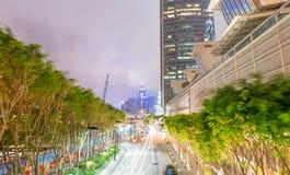 HONG KONG, MAJ - 12, 2014: Nowożytna miasto linia horyzontu przy nocą Hong Kon Fotografia Stock