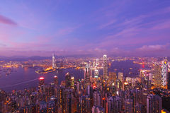 Hong Kong with many office buildings at sunset Stock Photos