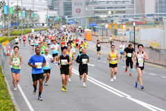 Hong Kong Marathon 2013. Despite the early-morning start, the energy and excitement of both runners and spectators was at a peak. Once the Honourable Leung Chun Royalty Free Stock Image