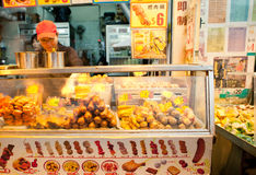 Hong Kong - MARCH 13: Food vendor on the street of Kowloon, Hong Kong on March 13, 2013. Royalty Free Stock Photography