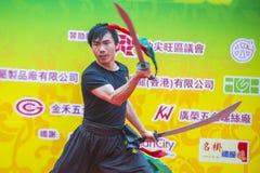 The 14th Tai Kok Tsui temple fair in Hong Kong. HONG KONG - MARCH 04 : Martial arts demonstration during the 14th Tai Kok Tsui temple fair in Hong Kong on March Royalty Free Stock Photo