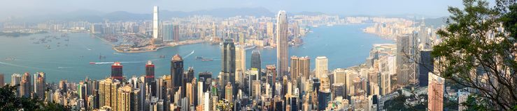 Panoramic view of Hong Kong`s Victoria Harbour and energetic Central business district stock image