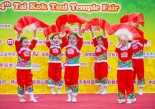 The 14th Tai Kok Tsui temple fair in Hong Kong. HONG KONG - MARCH 04 : Participants in the 14th Tai Kok Tsui temple fair in Hong Kong on March 04 2018. The Royalty Free Stock Photo