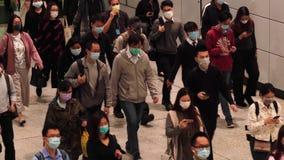 Hong Kong - March 10, 2020: Slow motion of people wearing medical face masks at metro. People Wearing Mask because of Coron