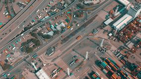 Hong Kong - May 1, 2018: Aerial view of a modern port container terminal. Import and export, business logistic. Arbor cranes and large ships stock video