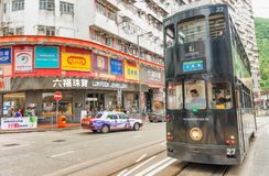 HONG KONG - MAY 11, 2014: Black Double Decker bus speeds up in c. Ity streets. They are a famous tourist attraction in the city Royalty Free Stock Images