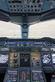 Emirates Airbus A380. HONG KONG - MAY 12, 2016: cockpit of Emirates Airbus A380. Emirates is one of two flag carriers of the United Arab Emirates along with Stock Photos