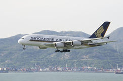 HONG KONG - May 28: Singapore Airlines Airbus A380 arrive in Hong Kong International Airport on May 28, 2014 in Hong Kong. Singapo Stock Photos