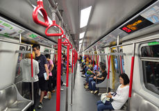 Hong Kong Metro. Passengers inside a subway train on November 9, 2013 in Hong Kong MTR. It is the most popular transport in Hong Kong stock photography