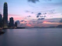 Hong Kong Modern Buildings at Sunset. The view of Hong Kong buildings ready lights up before at night Royalty Free Stock Image