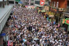 Hong Kong mot regering marscherar 2012 Royaltyfria Bilder