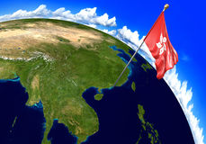 Hong Kong national flag marking the country location on world map. 3D rendering, parts of this image furnished by NASA Stock Image