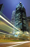 Hong Kong Night. Skyscraper with traffic light and cars motion blurred in Hong Kong Royalty Free Stock Photography
