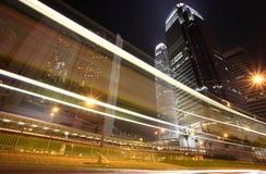 Hong Kong Night. Skyscraper with traffic lights and cars motion in Hong Kong Stock Photos
