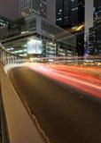 Hong Kong night. Cars motion blurred in Hong Kong Stock Photos
