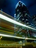 Hong Kong at Night. Skyscrapers with traffic lights and cars motion in Hong Kong at night Royalty Free Stock Photos