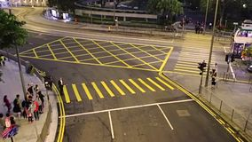 Traffic at the Night Crossroad of Hong Kong. Fast Motion. Hong Kong Night. Crossroads with pedestrian crossings. Lively traffic of people, cars, buses and famous stock video footage