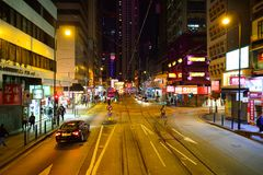 Hong Kong at night. HONG KONG - DECEMBER 25, 2015: view from upper deck of double-decker tramway. The tram is the cheapest mode of public transport on Hong Kong Stock Images