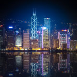 Hong Kong at night with reflections Stock Photos
