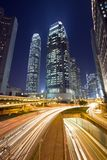 Hong Kong Night Scene with Traffic Light. Photo took at Central, Hong Kong Modern building in night with busy highway Royalty Free Stock Images