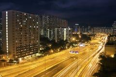 Hong Kong Night Scene with Traffic Light Stock Photos