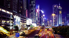 Hong Kong Night Timelapse. Causeway Bay. Wide Shot. City timelapse at night. Causeway Bay of Hong Kong. Corporate Buildings with commercial billboards. Busy stock video footage
