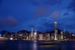 Hong Kong night view along Victoria Harbour. It is a very typical scene in Hong Kong, can view Central, Wan Chai and Causeway Bay Royalty Free Stock Image