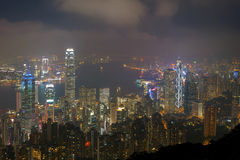 Hong kong night view from victoria harbour Stock Photos