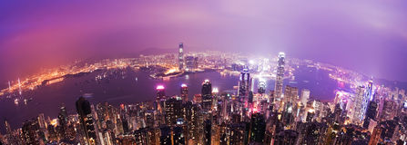 Hong Kong at night. View of Victoria Harbour in Hong Kong from the Peak, fisheye view Stock Images