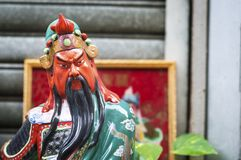 Statue of popular Chinese god Guan Yu at a street shrine in Hong. HONG KONG - NOV 2, 2013 - Guan Yu, also known as Guan Gong, is one of the most popular and stock images