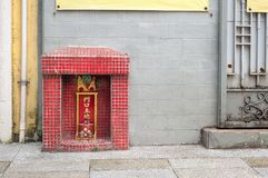 Small shrine to the earth god Tu Di on a Hong Kong street Stock Image