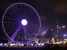 Hong Kong Observation Wheel- und Weihnachtskarneval stockbild