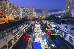 Hong Kong old market with housings at night Royalty Free Stock Photo